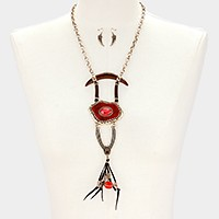 Abstract double horn & faux leather tassel necklace