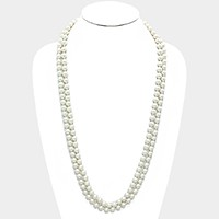 Long pearl strand necklace