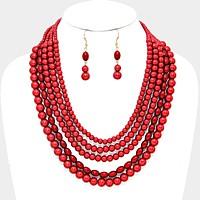 Multi-strand red pearl bead necklace