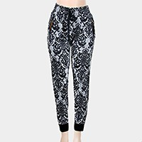 Gothic pattern drawstring jogger pants with zippers