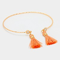 Crystal tip cuff bracelet with double tassel