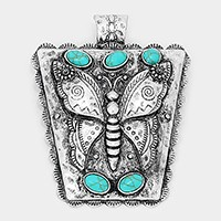 Metal butterfly & turquoise pendant