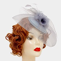 Feather accented birdcage veil & mesh flower fascinator