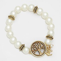 Wooden tree of life accented pearl strand stretch bracelet with pigeon charm