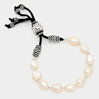 Antique bead accented pearl strand bracelet