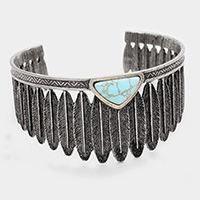 Turquoise accented metal feather cluster cuff bracelet
