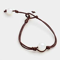 Pearl & coated cord bracelet