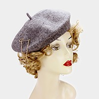 Wool beret hat with draped chain brooch