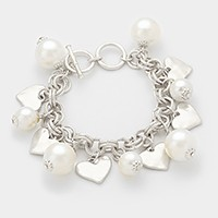 Hammered metal heart disc & pearl charm station toggle bracelet