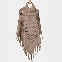 Turtleneck knit poncho with tassels