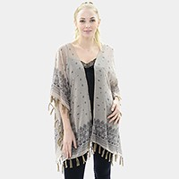 Patterned short sleeve poncho with tassel hem