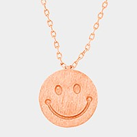 Textured matte metal smiley face pendant necklace