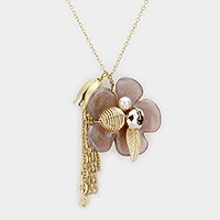 Glass bead detail flower & tassel charm necklace
