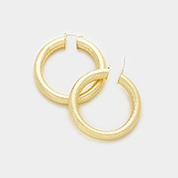 Textured metal hoop pin catch earrings