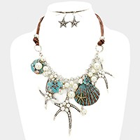 Pearl embellished starfish & shell multi-charm necklace