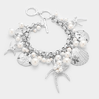 Pearl embellished starfish & shell multi-charm toggle bracelet