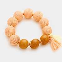 Thread & wood balls stretch bracelet with tassels