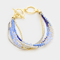 Braided thread & multi-strand bead toggle bracelet