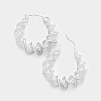 Twisted hoop pin catch earrings