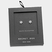 Secret box _ White gold dipped ship helm stud earrings