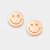 Matte textured metal smiley face stud earrings