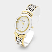 Embossed Oval Face Cuff Dial Watch