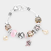 Multi Bead Heart Embossed Metal Pink Ribbon Bracelet